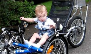 kid on adult tadpole trike