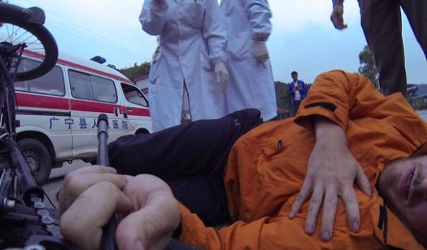Matt Galat laying on road