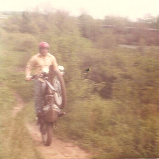 Steve riding wheelie up a hill
