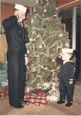 Jerry Steinman& Steve Newbauer in navy uniforms saluting each other