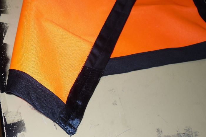 new safety flag with black border on pole 4