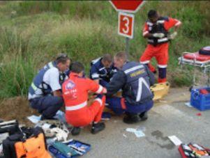 paramedics treating downed cyclist