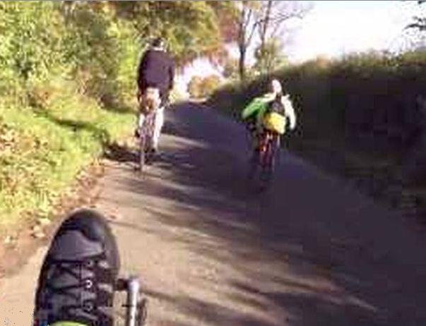 trike climbing hill behind 2 DF bikes cropped