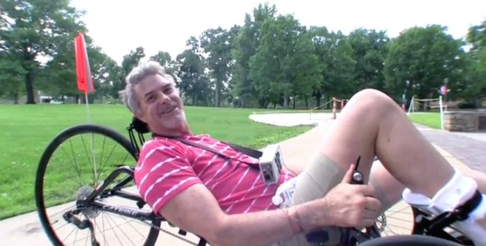 paraplegic riding tadpole trike