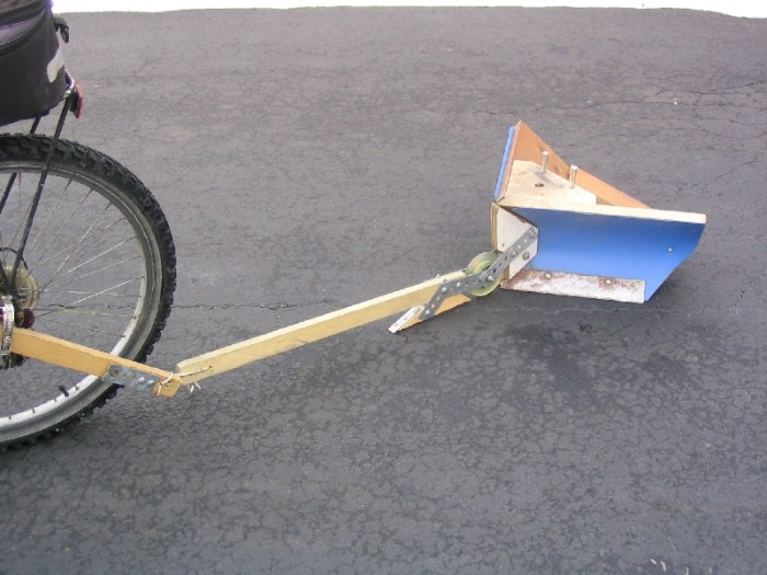 v plow towed by bicycle