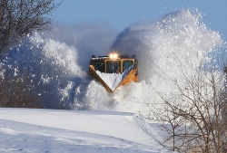V snow plow on train