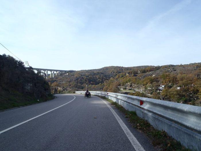 Chuck riding along a road