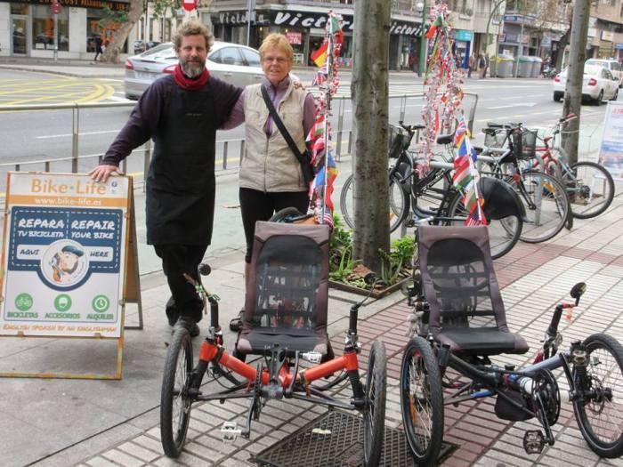 Susan Atkinson & bike mechanic with trikes
