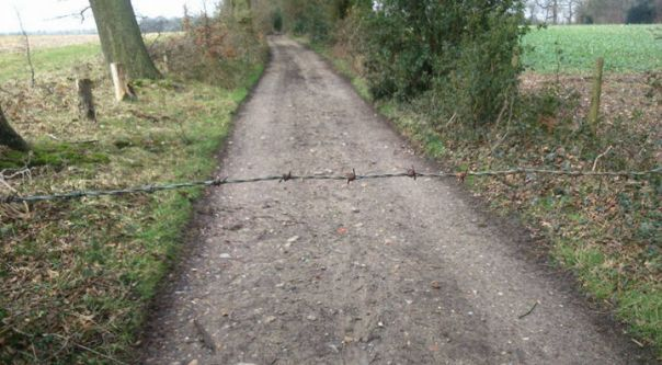 barb wire across trail