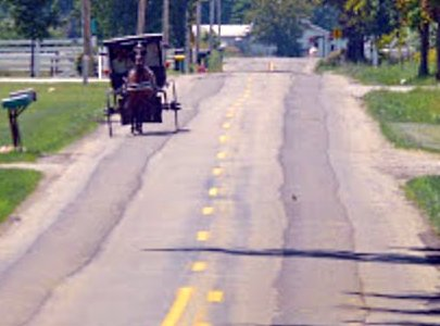 damaged road surface from Amish wagons