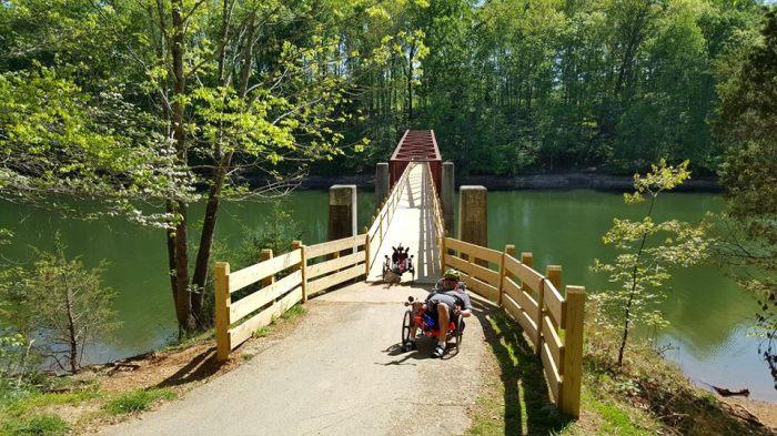 unique bridge over river on bike trail