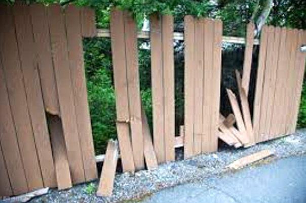 vandalized fence along trail