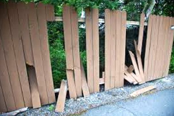 vandalized fence along trail